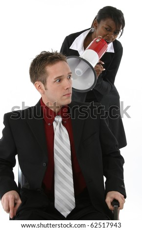 Attractive young business team over white background.  Woman yelling at man through megaphone. - stock photo