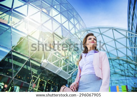 Attractive young business woman in front of the mall