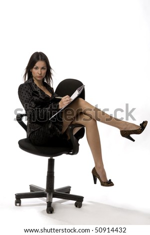 Attractive young business-woman is sitting and attentively listening - stock photo