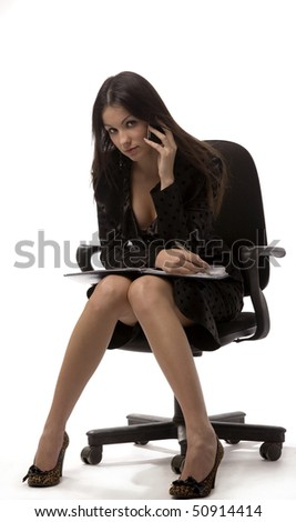 Attractive young business-woman is speaking by telephone - stock photo