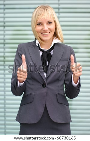 Attractive young business woman over modern background - stock photo