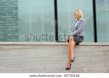 Attractive young business woman over modern background