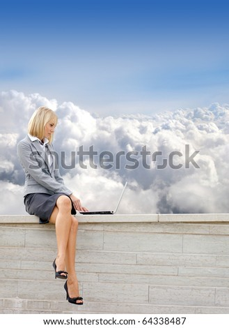 Attractive young business woman over sky  background - stock photo