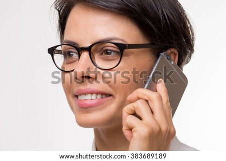 Attractive young business woman talks on her smartphone