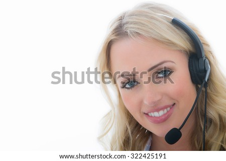 Attractive Young Business Woman Using a Telephone Headset Calling Clients Against A White Background
