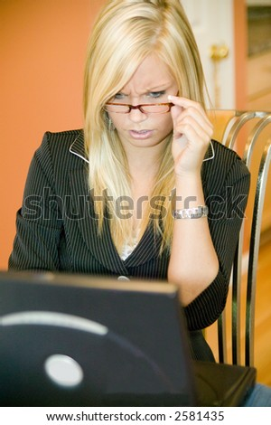 Attractive young business woman working from home.  Model Released