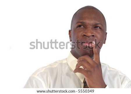 Attractive young businessman contemplating his next move - stock photo