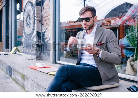 Attractive young businessman, having a break from work - stock photo