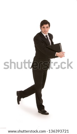 Attractive young businessman in a suit walking with a folder in his hand, full length mid stride studio portrait on white - stock photo