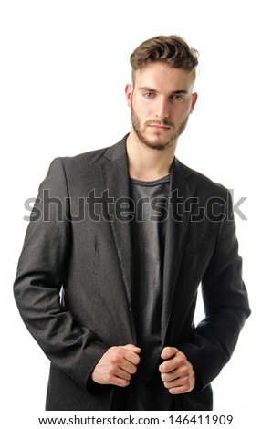 Attractive young businessman in dark suit, isolated on white background - stock photo