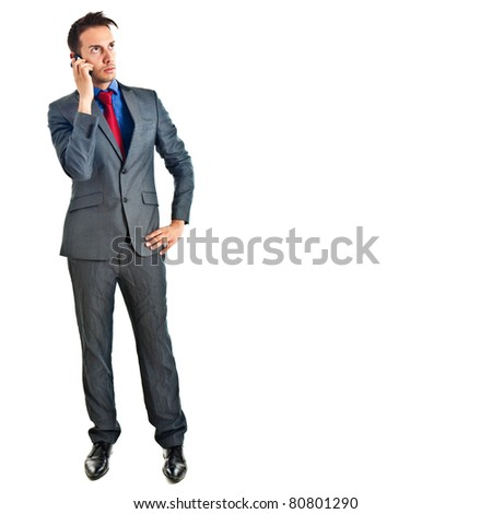 Attractive young businessman on mobile phone against white - stock photo