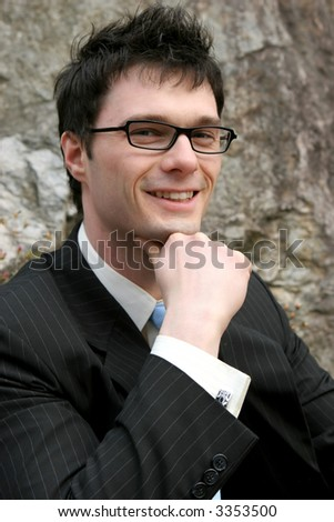 Attractive young businessman smiling. - stock photo