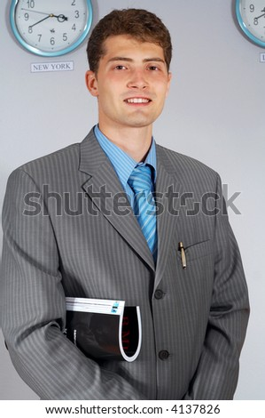 attractive young businessman with journal