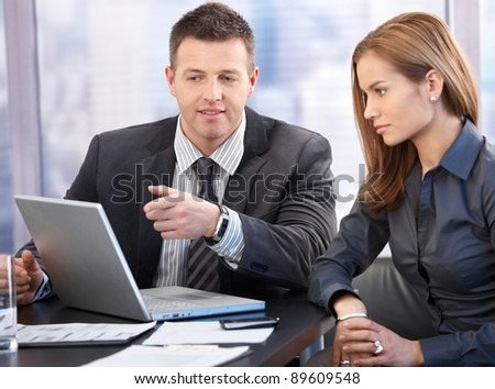 Attractive young businesspeople having discussion in boardroom.? - stock photo