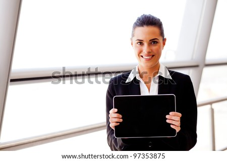 attractive young businesswoman holding a tablet computer - stock photo
