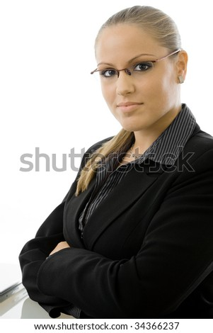 Attractive young businesswoman in black business suit, isolated on white background. - stock photo