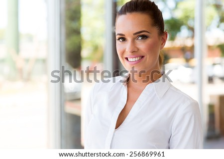 attractive young businesswoman in modern office - stock photo