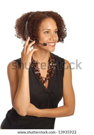 Attractive young businesswoman listening on a headset - stock photo