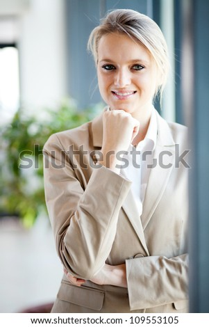 attractive young businesswoman portrait by window - stock photo