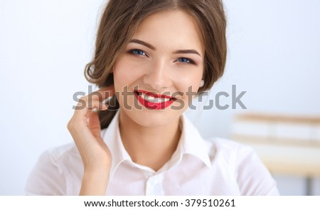 Attractive young businesswoman sitting  in the office
