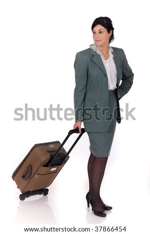 Attractive young businesswoman, traveler with suitcase.  Studio white background