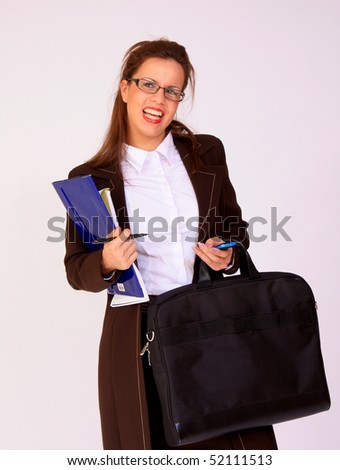 Attractive young businesswoman with eyeglasses - stock photo