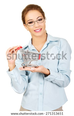 Attractive young businesswoman with shopping cart. - stock photo