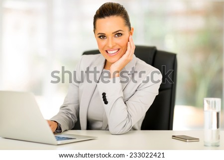 attractive young businesswoman working in office - stock photo