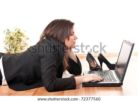 attractive, young businesswoman working on laptop at home - stock photo