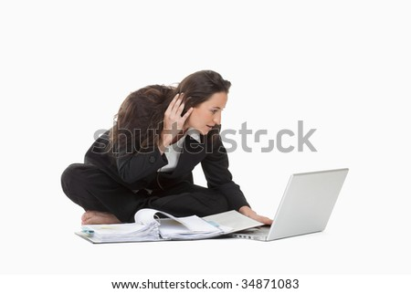 attractive young businesswoman working with laptop computer and files