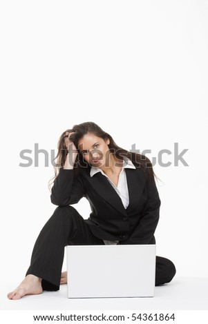 attractive young businesswoman working with laptop computer smiling