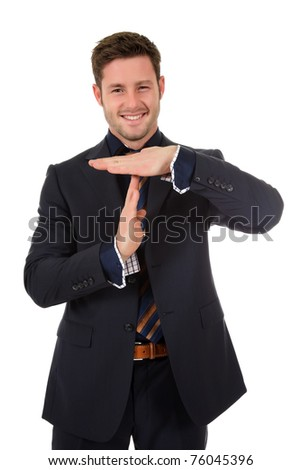 Attractive young caucasian businessman showing time out symbol. Studio shot. White background.