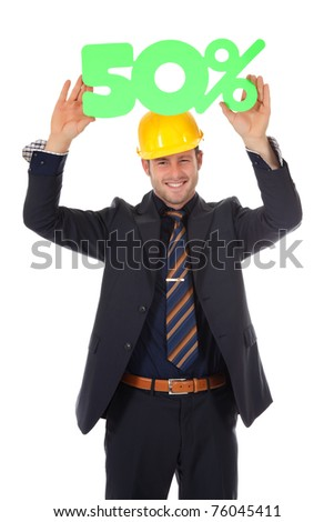 Attractive young caucasian businessman with helmet showing fifty percent discount sign overhead. Studio shot. White background. - stock photo