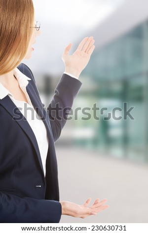 Attractive young caucasian businesswoman advertising - stock photo