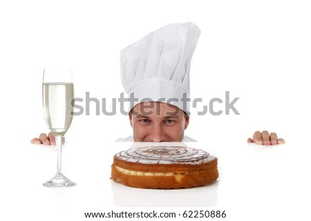 Attractive young caucasian chef man being tempted, peeping above table. Studio shot. White background. - stock photo
