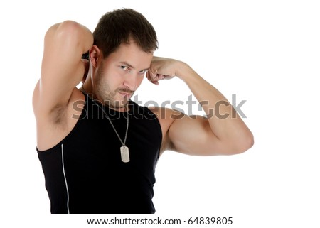 Attractive young caucasian man showing biceps and triceps muscles. Studio shot. White background. - stock photo