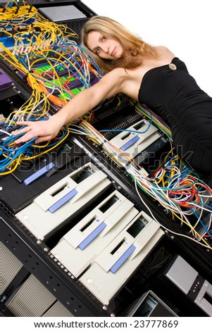 Attractive young caucasian model against server racks - stock photo