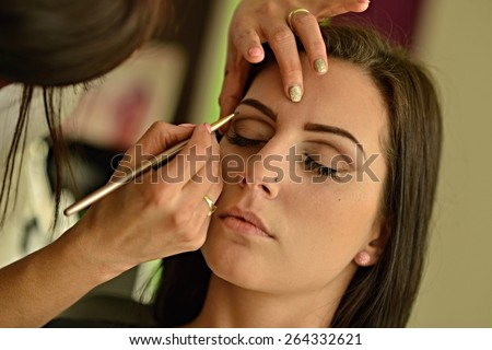 attractive young caucasian woman.beautiful woman with brushes. - stock photo