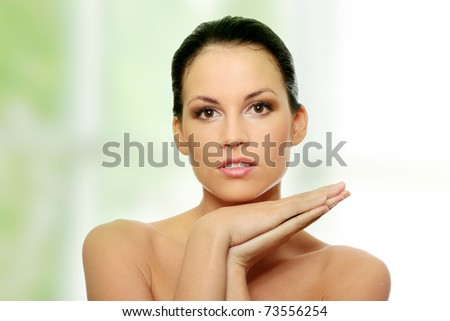 Attractive young caucasian woman face with perfect skin before spa. - stock photo