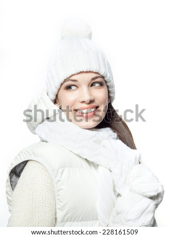 attractive young caucasian woman in warm clothing  in studio, isolated on white smiling - stock photo