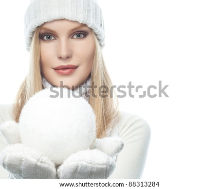 attractive young caucasian woman in warm clothing  isolated on white with snowball - stock photo