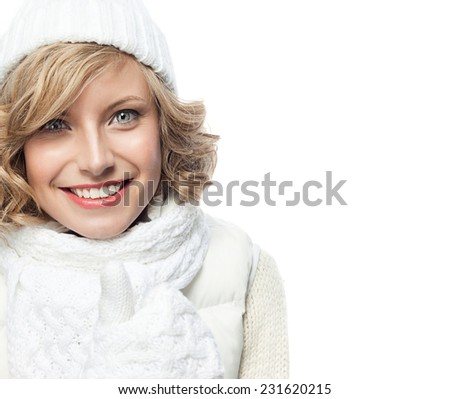 attractive young caucasian woman in warm clothing  studio shot isolated on white smiling happy toothy smile winter - stock photo