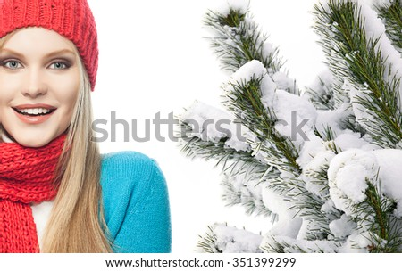 attractive young caucasian woman in warm colorful clothing  studio shot isolated on white smiling christmas tree snow covered new year