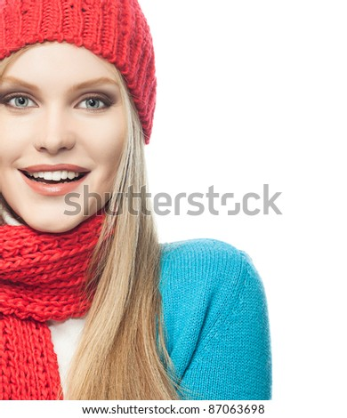 attractive young caucasian woman in warm colorful clothing  studio shot isolated on white smiling