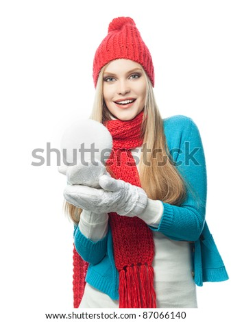 attractive young caucasian woman in warm colorful clothing  studio shot isolated on white smiling with snowball - stock photo