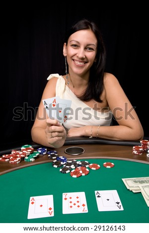 Attractive young caucasian woman wins with two ace in the casino - stock photo