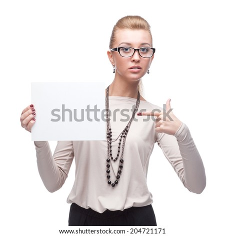 attractive young cheerful caucasian businesswoman holding and pointing at sign isolated on white - stock photo