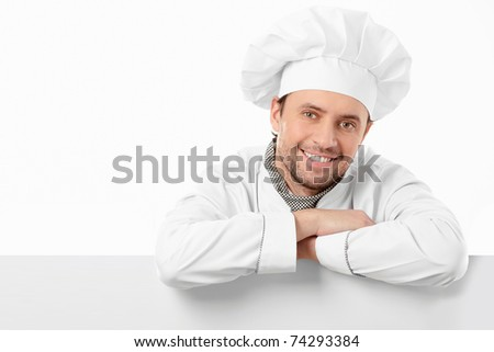 Attractive young chef on a white background - stock photo