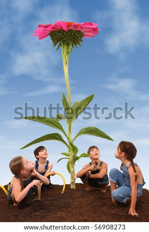 Attractive young children growing a giant cone flower.