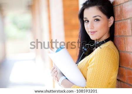 attractive young college girl reading book - stock photo